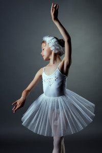 portrait of nice little girl dancing role of White Swan
